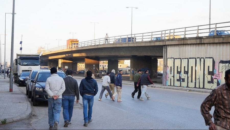 Construction workers in Jisr el wati. 2014. Video Still by Lamia Joreige. Courtesy Lamia Joreige.